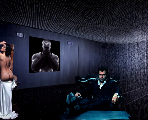 Dom and cornered girl under portrait of DJ Black on the wall