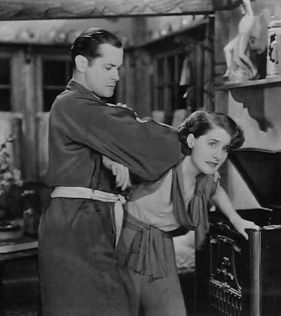 Robert Montgomery about to give Norma Shearer a wartime spanking