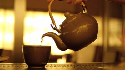hot-water-pouring-from-tea-pot-to-tea-cup